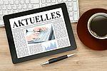 "Symbolbild: Tablett mit ""Aktuelles"" im Display"