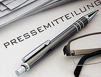 Symbolbild: eine Pressemitteilung und ein Kuli